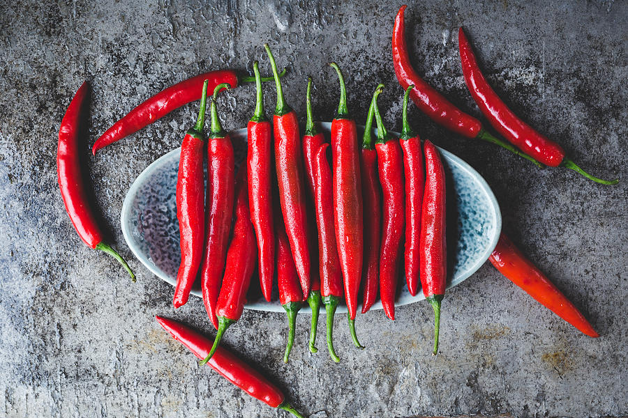 Close-Up Of Red Chili Peppers On Table Photograph by Thu Thai Thanh / EyeEm