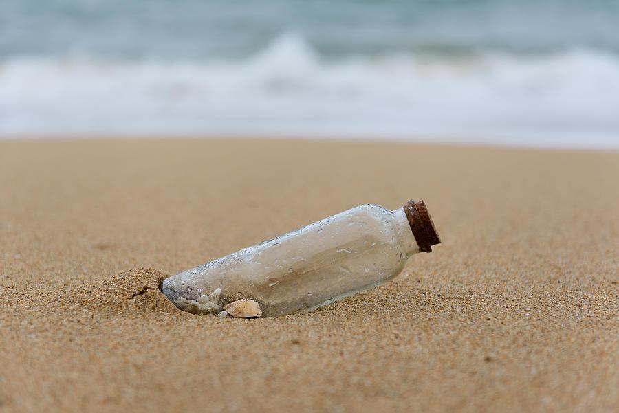 Close-Up Of Shells In Glass Bottle At Beach Photograph by Zhijian Yu / EyeEm