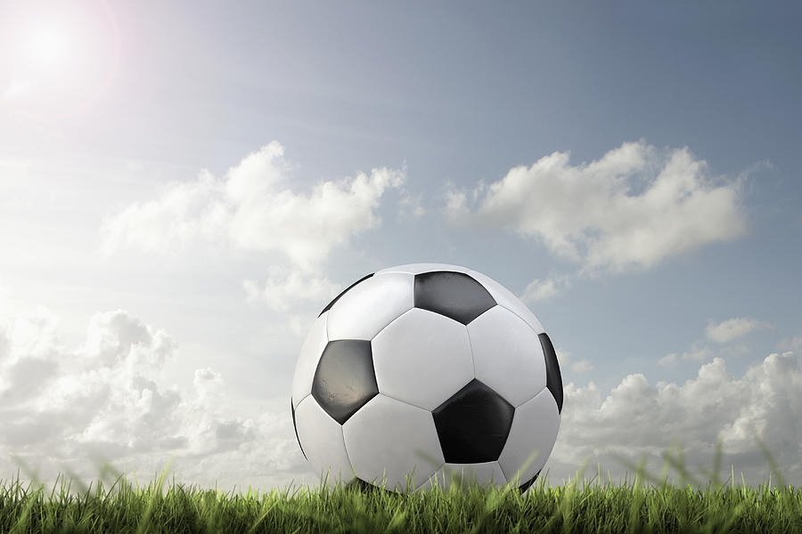 Close up of soccer ball in grass Photograph by Chris Clor