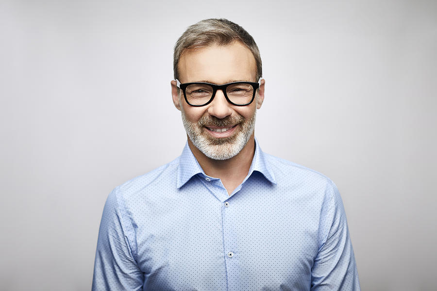 Close-up smiling male leader wearing eyeglasses Photograph by Morsa Images