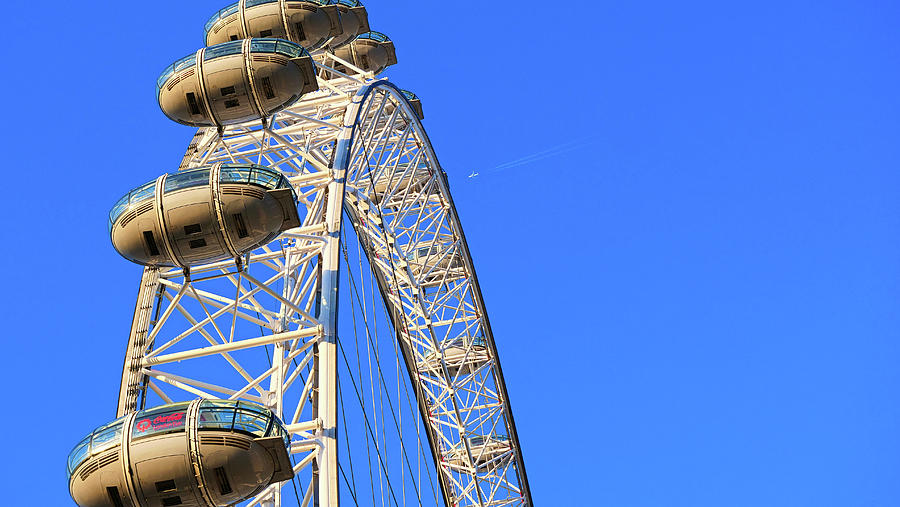 Closeup Of Capsules attached To London Eye and an airplane by Santosh Puthran