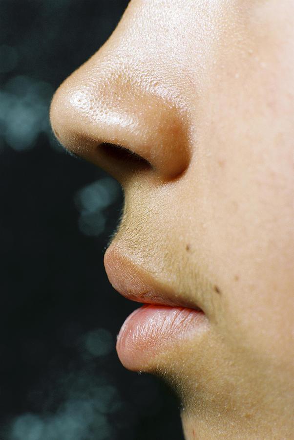 Closeup of lips and nose Photograph by BananaStock