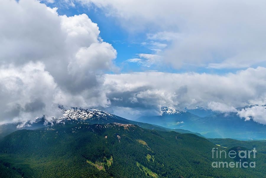 Clouds Over Mountain Peaks. Photograph