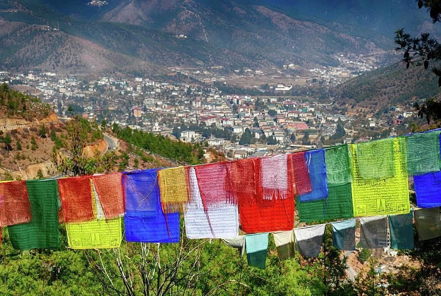 Colored prayer flags overlooking the city  by Steve Estvanik