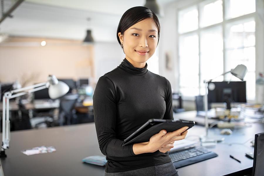 Confident asian businesswoman in office Photograph by Alvarez