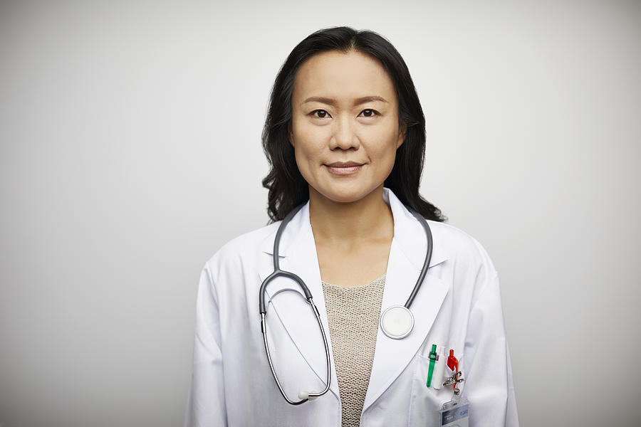 Confident portrait of female doctor in lab coat Photograph by Morsa Images