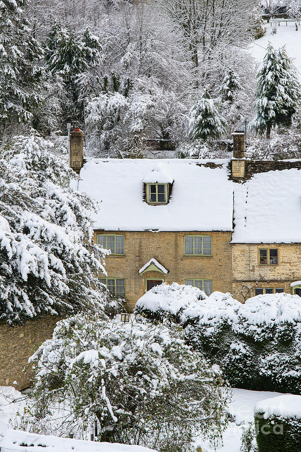 Cotswold Cottage in Chedworth in the Snow by Tim Gainey