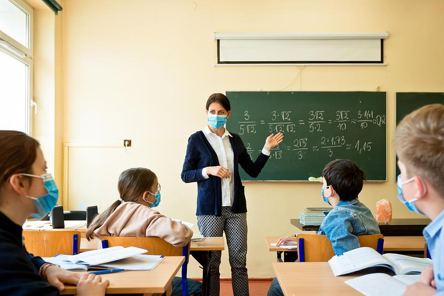 Covid-19. A teacher teaches mathematics Photograph by Izusek