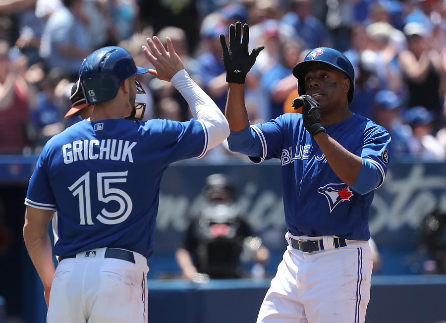Curtis Granderson and Randal Grichuk Photograph by Tom Szczerbowski