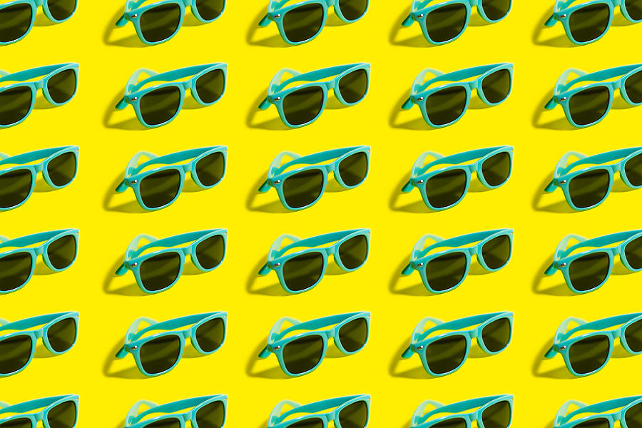 Cyan, Aqua Menthe Sunglasses Pattern Isolated On Background Of Yellow Color. Photograph