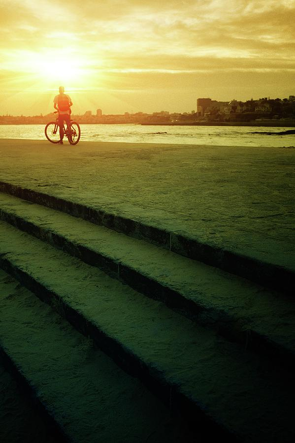 Cyclist at Sunset by Carlos Caetano