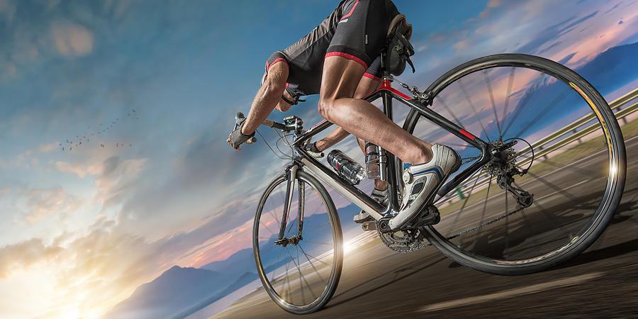 Cyclist Moving Fast On Coastal Path Photograph by Peepo