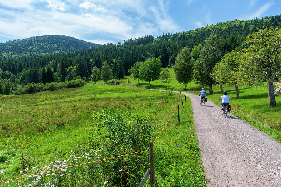 Color Photograph - Cyclists By The Lake Schluchsee by Vicen Photography