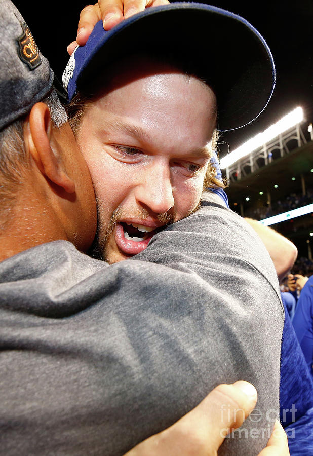 Dave Roberts and Clayton Kershaw Photograph by Jamie Squire