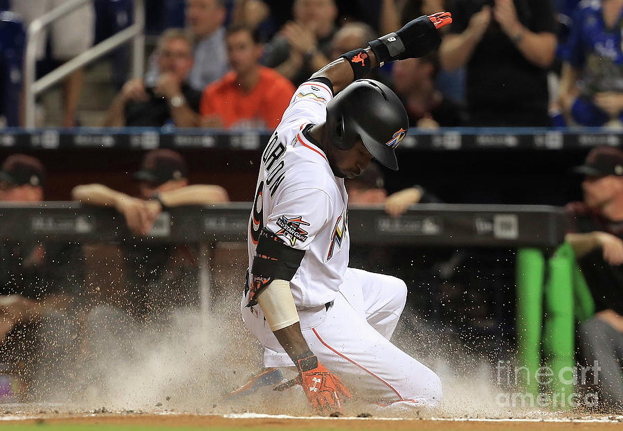 Dee Gordon and Giancarlo Stanton Photograph by Mike Ehrmann