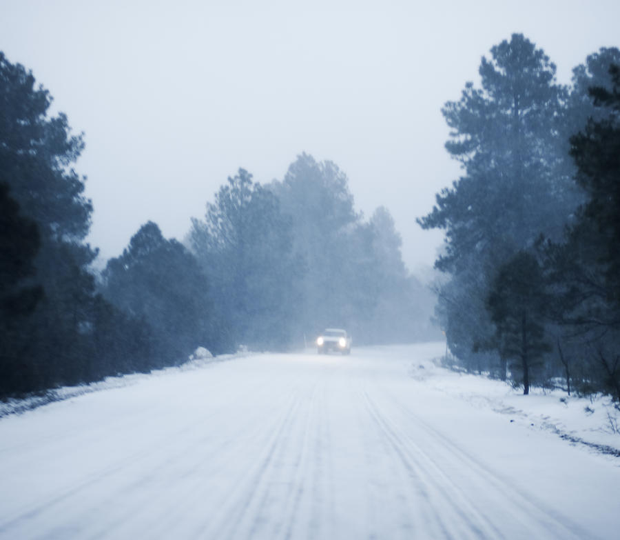 Defocused Car driving in snow along rural road Photograph by Lyn Holly Coorg