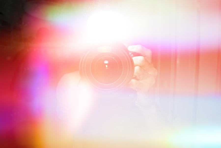 Defocused Image Of Person Photographing Amidst Colorful Lights Photograph by Frank Swertz / EyeEm