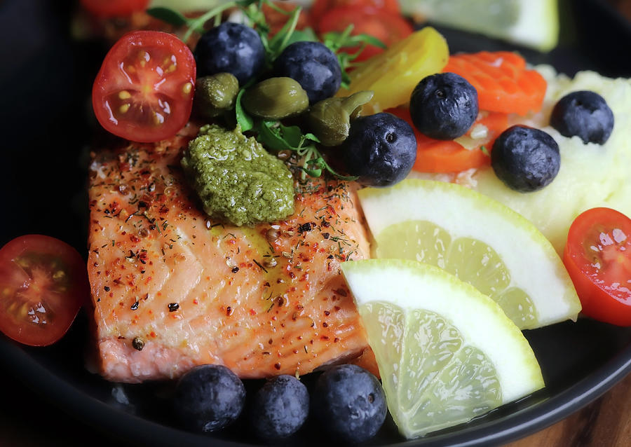 Delicious And Healthy Salmon With Blueberries Tomatoes And Capers Photograph