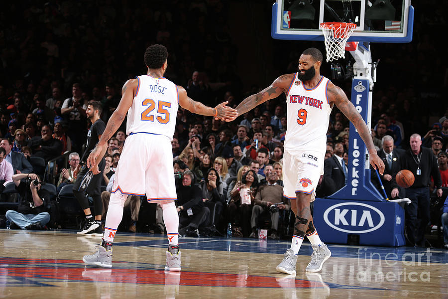 Derrick Rose and Kyle Oquinn Photograph by Nathaniel S. Butler