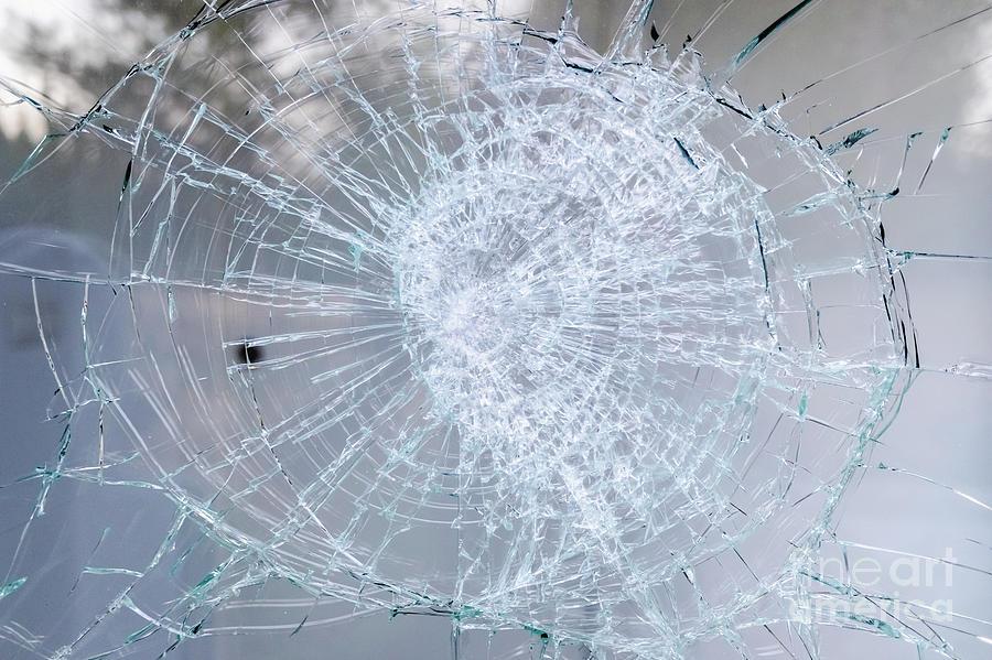 Detail of a broken glass of a window. by Joaquin Corbalan