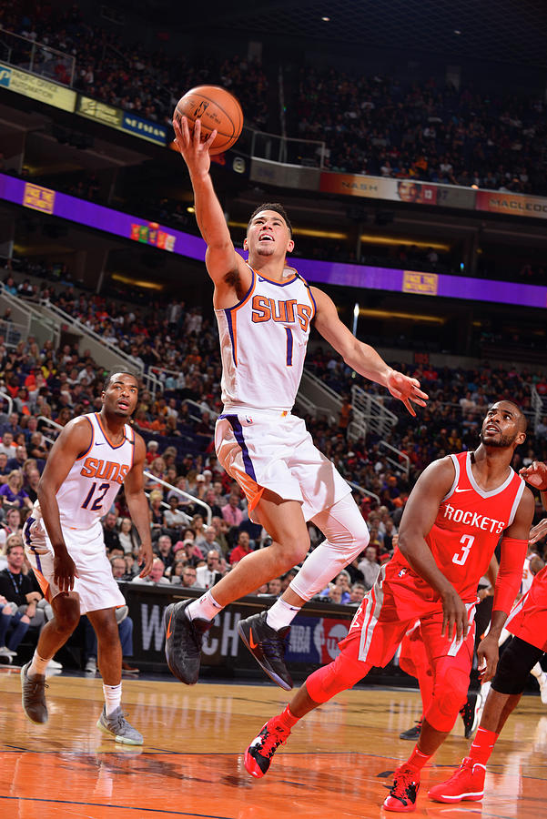 Devin Booker and Chris Paul Photograph by Barry Gossage