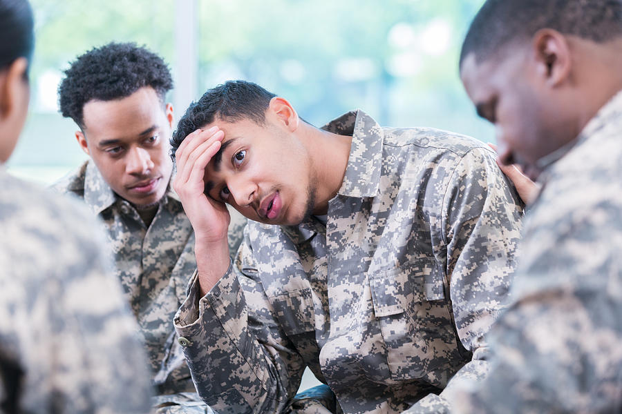 Distraught solider during support group meeting Photograph by SDI Productions