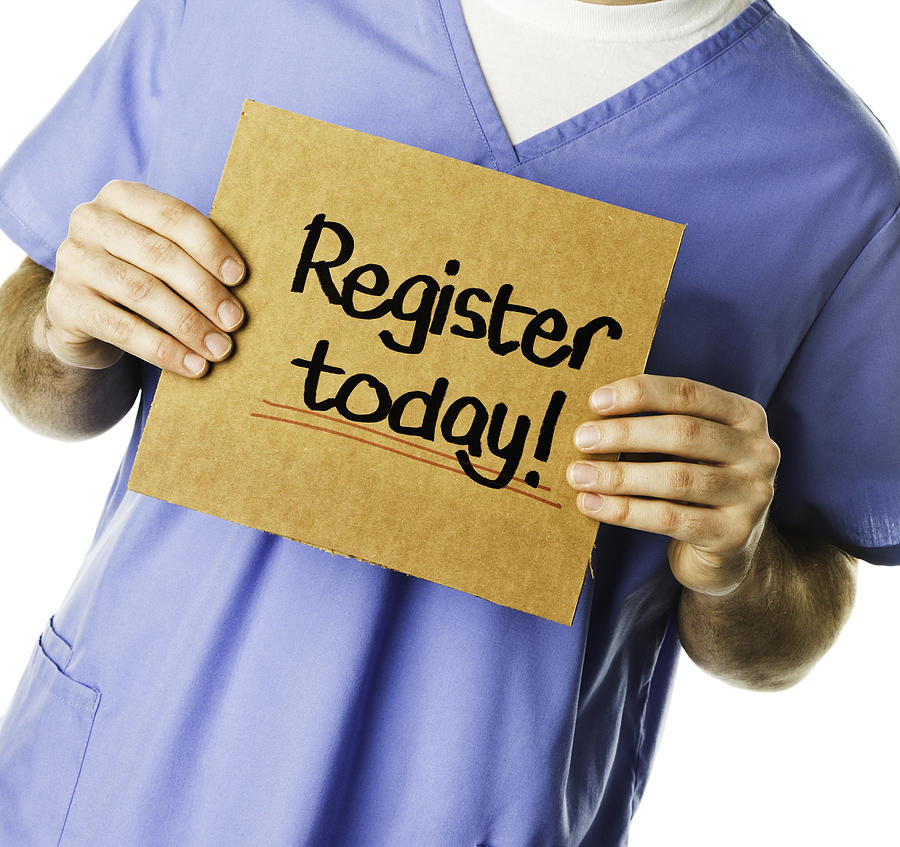 Doctor with Sign: Register Today! Photograph by CatLane