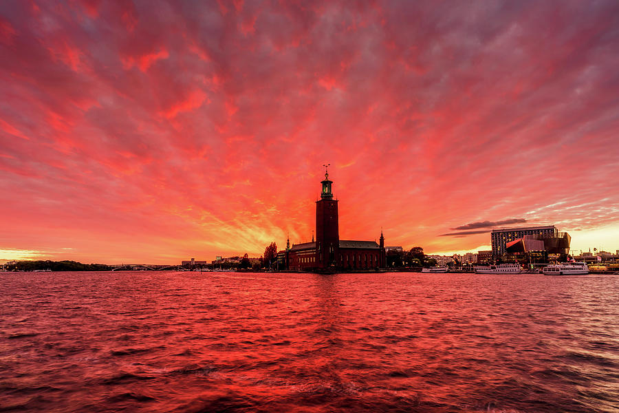 Fiery Photograph - Dramatic Red and Purple sunset over the Stockholm City Hall by Dejan Kostic
