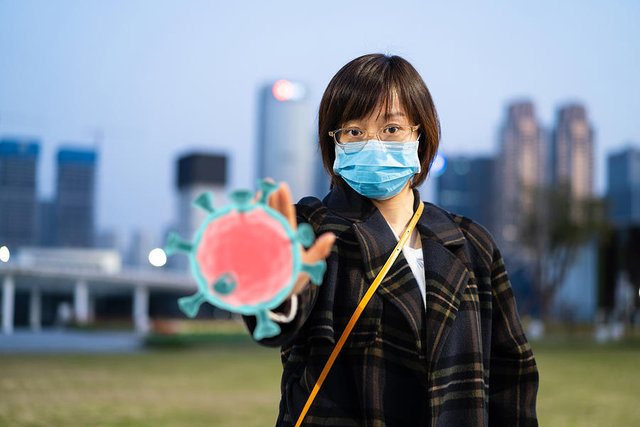 East Female Using Mask Protect From Virus Photograph by Dowell