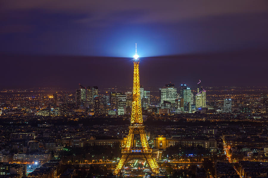 Eiffel Tower In Paris Seen At Night. Photograph