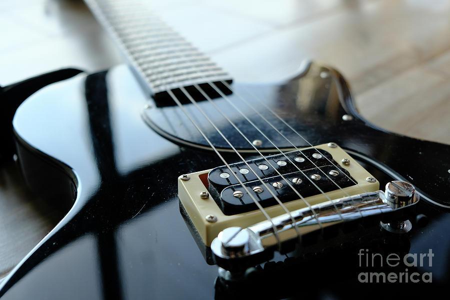 electric guitar bridge closeup by Luca Lorenzelli