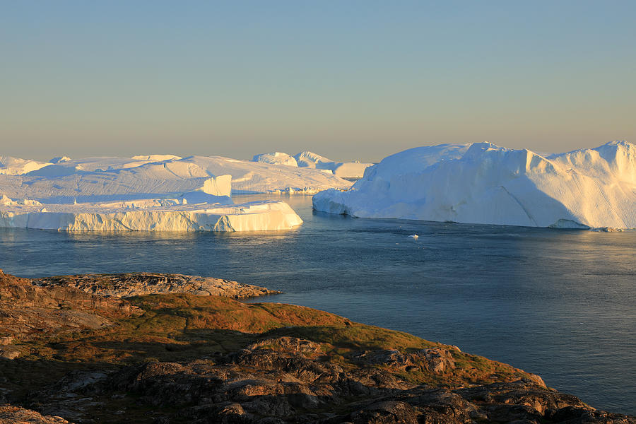 Elevated view at huge icebergs in the Icefjord at late afternoon Photograph by Rainer Grosskopf
