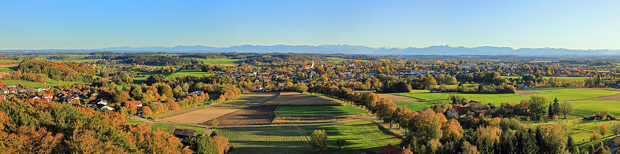 Elevated view of a typical bavarian small town with a prominent church in autumn and the Alps in the background Photograph by Rainer Grosskopf