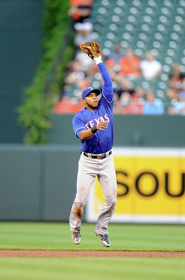 Elvis Andrus And Ryan Flaherty Photograph by Greg Fiume
