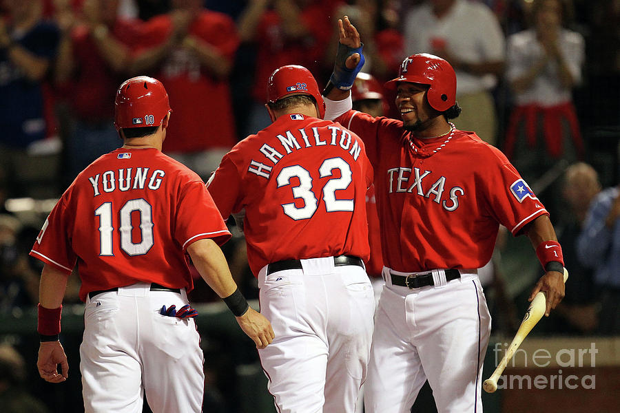 Elvis Andrus, Michael Young, and Josh Hamilton Photograph by Ronald Martinez