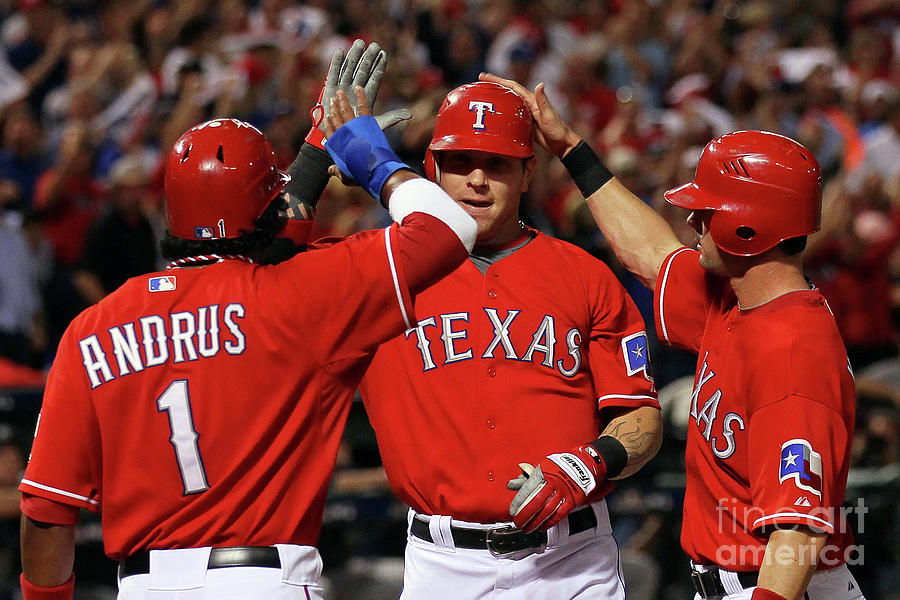 Elvis Andrus, Michael Young, and Josh Hamilton Photograph by Stephen Dunn