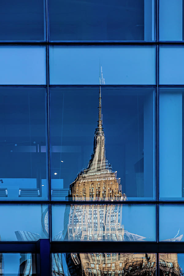 Empire State Building in Refective Window by Robert Ullmann