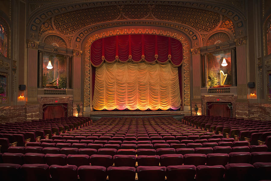Empty seats in ornate movie theater Photograph by Ariel Skelley