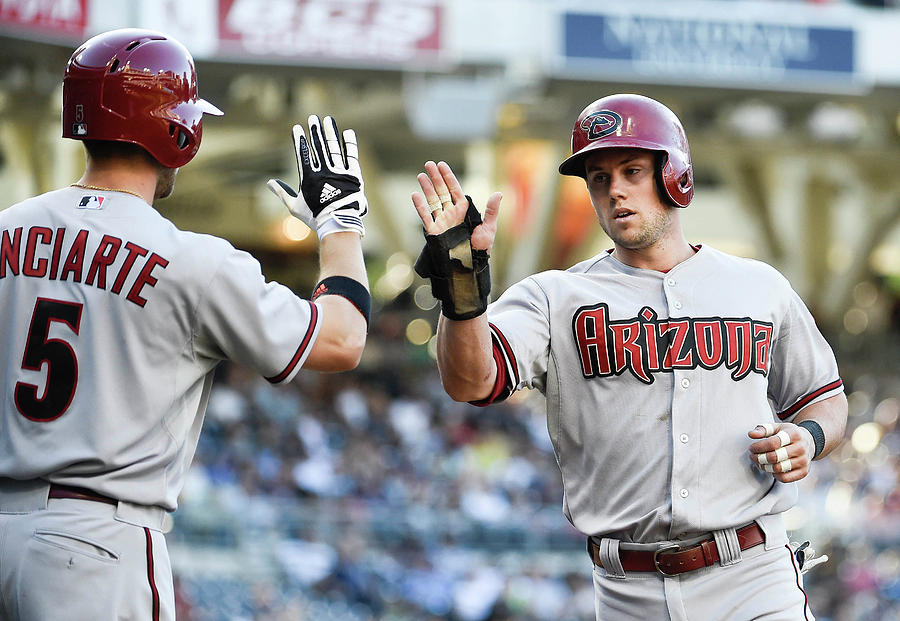 Ender Inciarte and Chris Owings Photograph by Denis Poroy