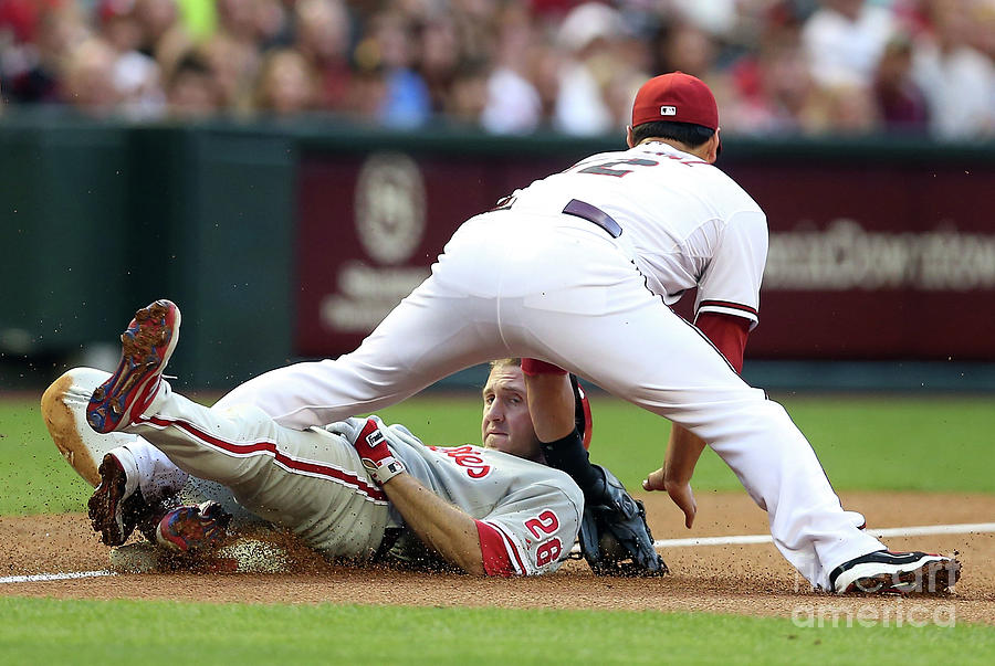 Eric Chavez And Chase Utley Photograph by Christian Petersen