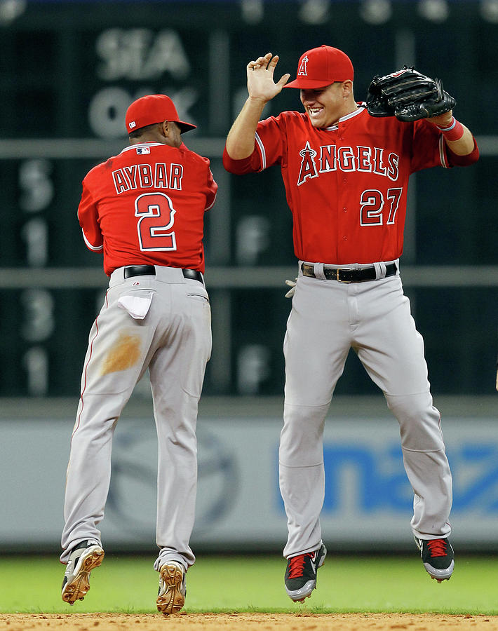 Erick Aybar And Mike Trout Photograph by Bob Levey
