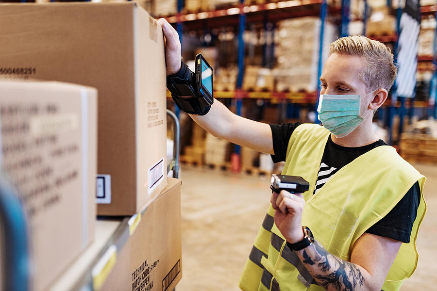 Essential workers in service and delivery industry with face mask during covid-19 pandemic Photograph by Drazen_