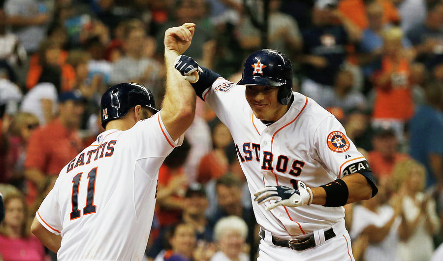 Evan Gattis and Carlos Correa Photograph by Scott Halleran