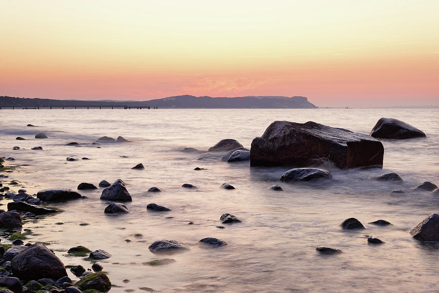 Stones Photograph - Evening light at the stone beach by Ralf Lehmann