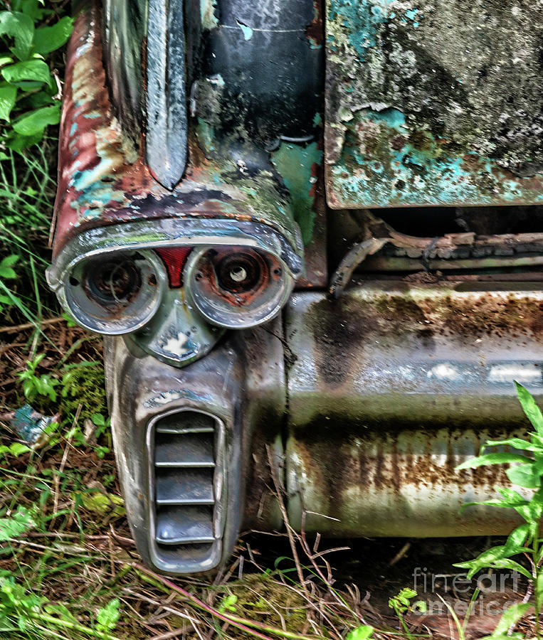 Face In The Bumper Of A Classic Car Photograph