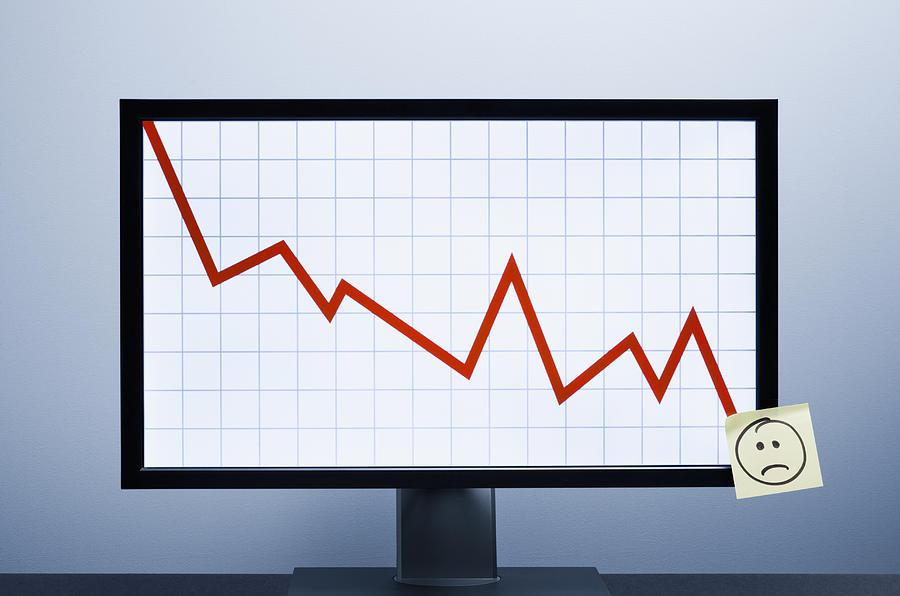 Falling financial graph Photograph by Jorg Greuel