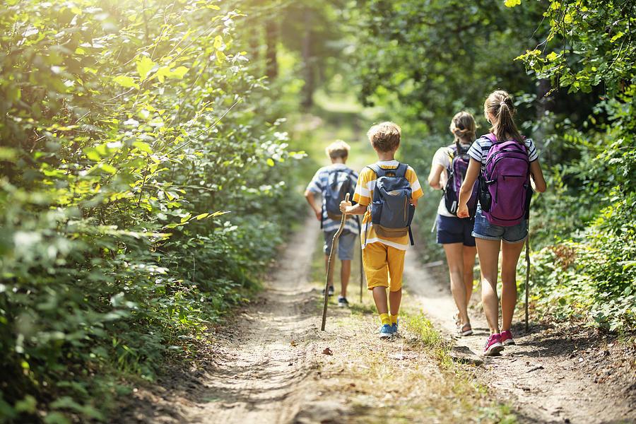 Family enjoying hiking together Photograph by Imgorthand