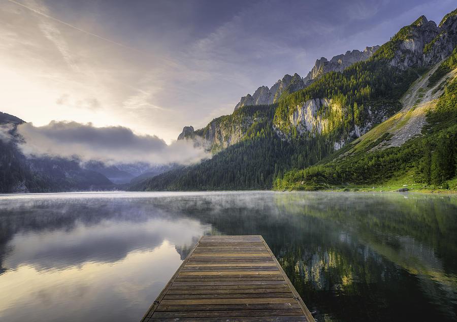 Fantastic Sunrise Scene with Fog Over Lake at azure alpine lake Vorderer Gosausee. Gosau valley in Upper Austria Photograph by Ratnakorn Piyasirisorost