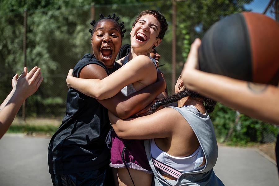 Female basketball team celebrating a victory Photograph by Luis Alvarez