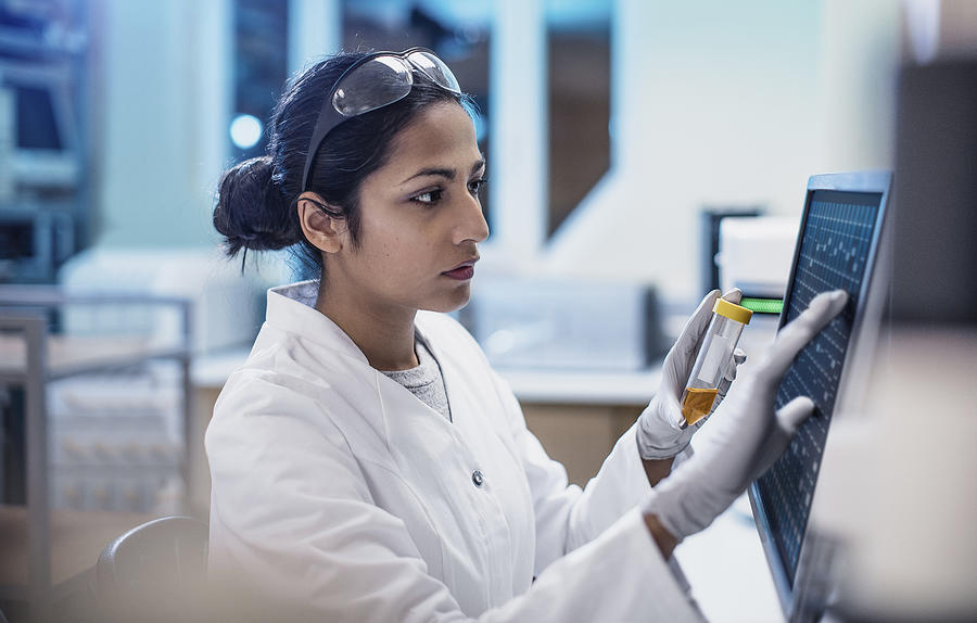 Female Scientist Working in The Lab, Using Computer Screen Photograph by Sanjeri